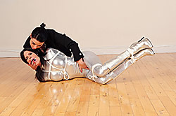 Ashley in silver catsuit & boot tied up by JJplush