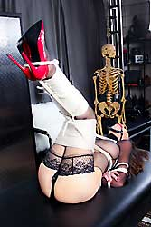 Ashley Renee in lingerie and stockings covered of ropes